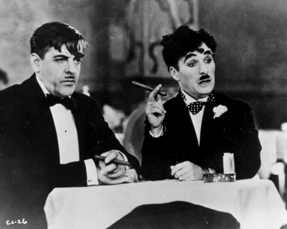 Charlie Chaplin and man dining